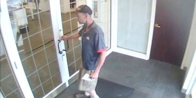 Video surveillance shows Menser walking into a bank with a demand note saying he has a gun.