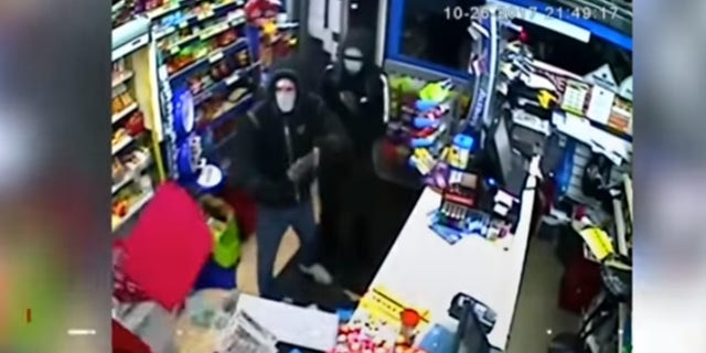 Police in the United Kingdom are looking for two would-be robbers who were chased from a store by an employee who threw what appeared to be alcohol at them.