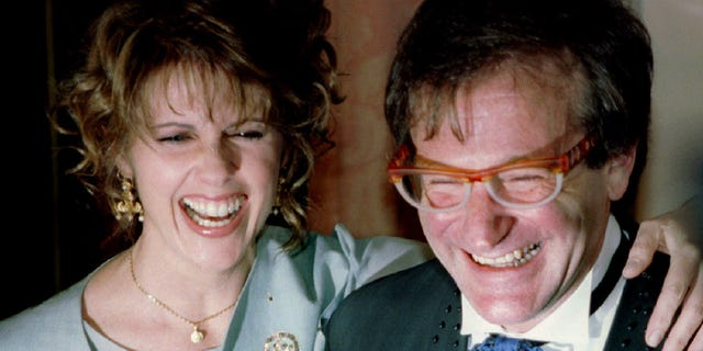 Pam Dawber shares a laugh with Robin Williams before the annual American Museum of the Moving Image Tribute dinner on Feb. 23, 1995, in New York.