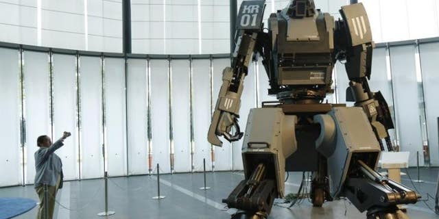 """The """"Kuratas"""" military robot in Tokyo, seen above, can be controlled by a pilot or via a smartphone. It is armed with a futuristic weapons system."""