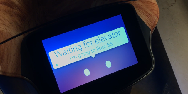 """This """"robot butler' is waiting for the elevator that is calls autonomously as it makes its way to the 55th floor for a delivery"""