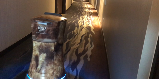 A 'robot butler' roams down the hotel corridor at the Vdara Hotel and Spa in Las Vegas on its way to make a delivery