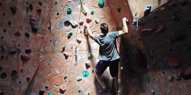 Rock climber on indoor climbing gym