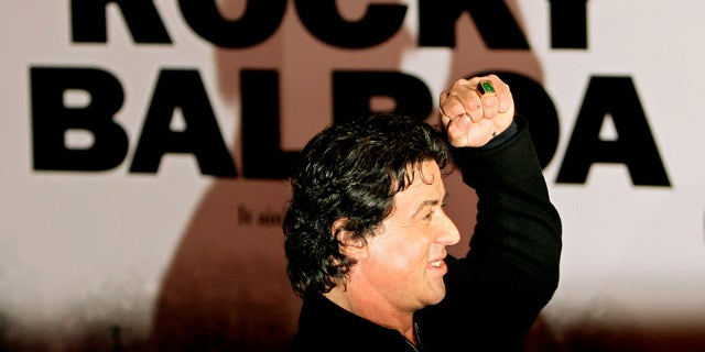 "U.S. actor Sylvester Stallone poses as he arrives for the British premiere of his latest film ""Rocky Balboa"" at The Vue Cinema in London's Leicester Square January 16, 2007.   REUTERS/Dylan Martinez    (BRITAIN) - RTR1L9NU"