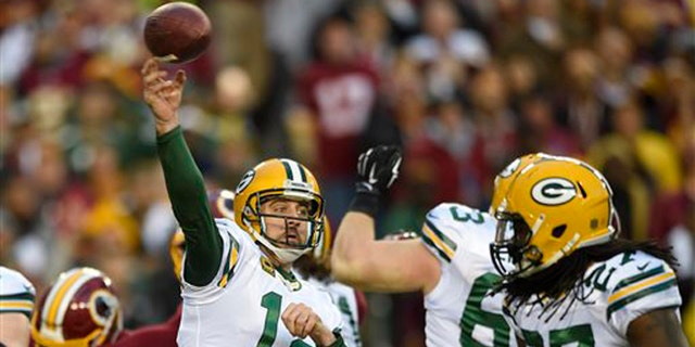 Green Bay Packers quarterback Aaron Rodgers (12) throws a pass during the first half of an NFL wild card playoff football game against the Washington Redskins in Landover, Md., Sunday, Jan. 10, 2016. (AP Photo/Nick Wass)