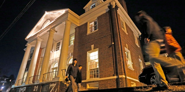 A Jan. 15, 2015, file photo shows students participating in rush pass by the Phi Kappa Psi house at the University of Virginia in Charlottesville. The house was depicted in a debunked Rolling Stone story as the site of a rape in September of 2012.