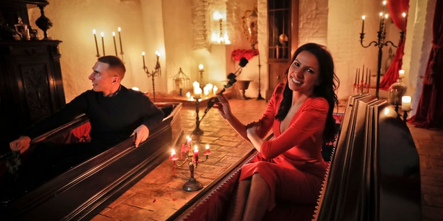 Events manager Tami Varma and her brother Robin, a PhD student, the grandchildren of Devendra Varma, a scholar of English gothic tales and an expert in vampire lore, pose in coffins at Bran Castle, in Bran, Romania, Monday, Oct. 31, 2016. A Canadian brother and sister are passing Halloween night curled up in red velvet coffins in the Transylvanian castle that inspired the Dracula legend, the first time in 70 years anyone has spent the night in the gothic fortress after they bested 88,000 people who entered a competition hosted by Airbnb to get the chance to dine and sleep at the castle in Romania.