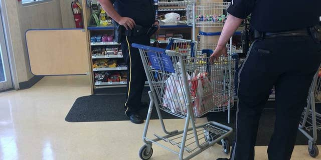 The officers took the teen grocery shopping when they learned he didn't have food in his home.
