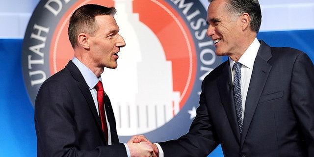 Utah Senate candidates, state Rep. Mike Kennedy, R-Alpine, left, and former Massachusetts Gov. Mitt Romney shake hands at the beginning of a Senate Republican primary debate, May 29 in Provo, Utah.