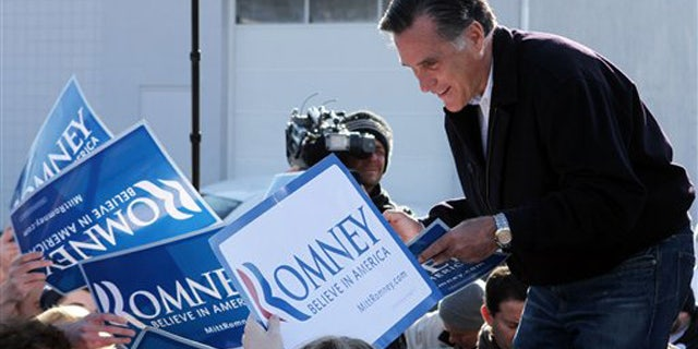 Dec. 3, 2011: Mitt Romney speaks to supporters and volunteers during a rally in Manchester, N.H.