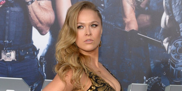 """Cast member Ronda Rousey attends the premiere of the film """"The Expendables 3"""" in Los Angeles August 11, 2014. REUTERS/Phil McCarten (UNITED STATES - Tags: ENTERTAINMENT) - RTR422A9"""