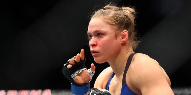 December 30, 2016; Las Vegas, NV, USA; Ronda Rousey fights against Amanda Nunes during UFC 207 at T-Mobile Arena. Mandatory Credit: Mark J. Rebilas-USA TODAY Sports - RTX2X0IR