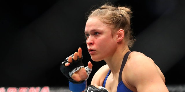 December 30, 2016; Las Vegas, NV, USA; Ronda Rousey fights against Amanda Nunes during UFC 207 at T-Mobile Arena. Mandatory Credit: Mark J. Rebilas-USA TODAY Sports