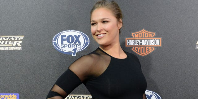 Sep 9, 2014; Los Angeles, CA, USA; FC Women's Bantamweight champion Ronda Rousey arrives on the Red Carpet at Lure Nightclub for the premier of The Ultimate Fighter women in the newly formed women in the strawweight class. Mandatory Credit: Jayne Kamin-Oncea-USA TODAY Sports - RTX173LW