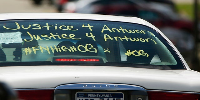 One of the vehicles in the funeral procession for Antwon Rose Jr. has a message displayed as it arrives at the Woodland Hills Intermediate school.