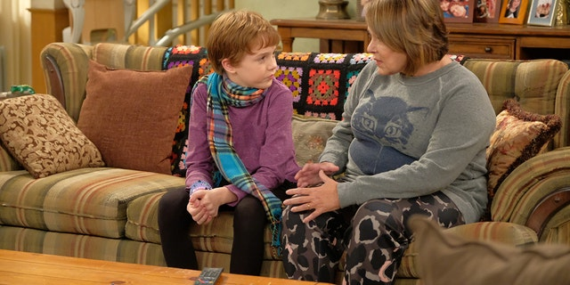 """ROSEANNE - """"Dress to Impress"""" - After being bullied, Darlene's son, Mark, gets caught with a pocket knife on the first day of his new school. Meanwhile, Becky invites Andrea over to meet the family and is nervous to bring her home, on the season premiere and second episode of the revival of """"Roseanne,"""" TUESDAY, MARCH 27 (8:30-9:00 p.m. EDT), on The ABC Television Network. (ABC/Adam Rose)AMES MCNAMARA, ROSEANNE BARR"""