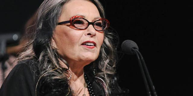 """Despite not graduating high school and not being on the reunion committee's """"stinking mailing list,"""" Roseanne was invited to her high school reunion by a caller on """"Larry King Live."""""""