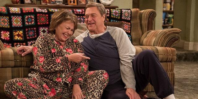 """Roseanne Barr and her on-screen husband John Goodman in """"Roseanne."""""""