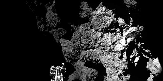 Rosetta's lander Philae is safely on the surface of Comet 67P/Churyumov-Gerasimenko, as these first two CIVA images confirm. One of the lander's three feet can be seen in the foreground. ( ESA/Rosetta/Philae/CIVA)