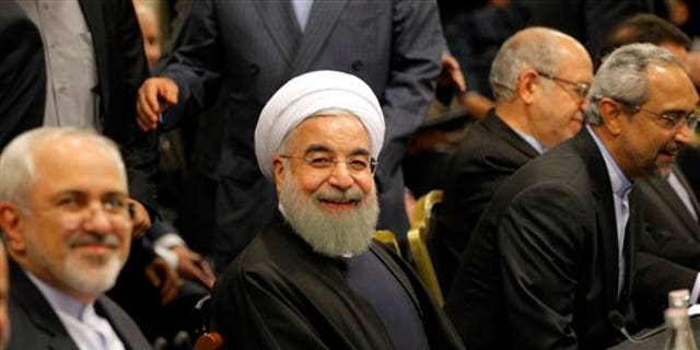 """Iranian President Hassan Rouhani smiles ahead of a meeting in Paris, Wednesday, Jan. 27, 2016. Rouhani says his first visit to Europe since the nuclear accord was signed has proven that there are """"great possibilities"""" for economic, academic, scientific and cultural cooperation and that """"today we are in a win-win situation"""" after years of mutual losses due to sanctions. (AP Photo/Christophe Ena)"""