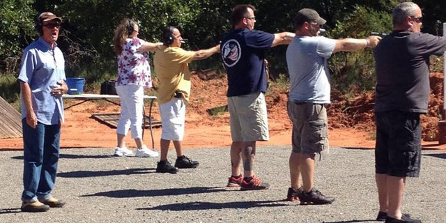 Concealed weapons instructor Roy Jones with students on his shooting range in Oklahoma.
