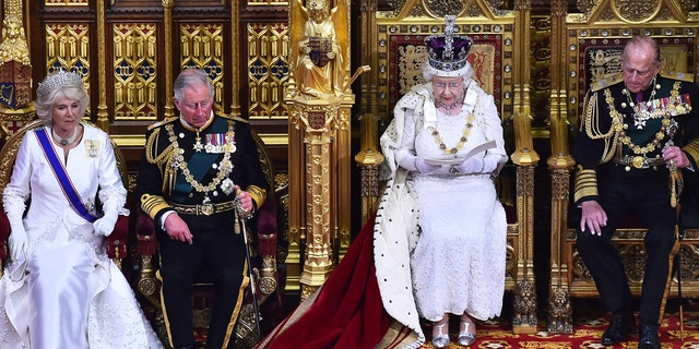 Camilla Bowles and Prince Charles sit beside the Queen during a 2015 event.