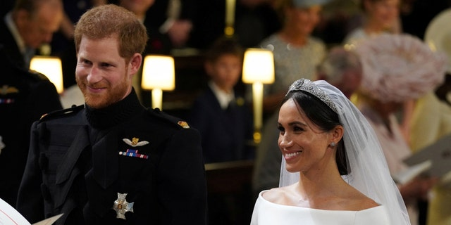 Prince Harry and Meghan Markle in St George's Chapel at Windsor Castle during their wedding service Windsor, Britain May 19, 2018.