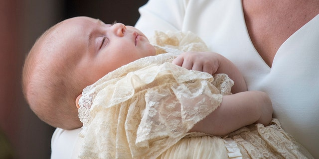 Prince Louis sleeps through his royal christening.