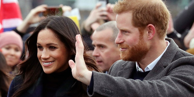 Britain's Prince Harry and Meghan Markle during a walkabout with Britain's Prince Harry on the esplanade at Edinburgh Castle, Scotland, Tuesday, Feb. 13, 2018. The recently engaged couple are on a one day tour to Edinburgh, and will visit the Castle and observe the firing of the One O'clock Gun. (Andrew Milligan/Pool Photo via AP)