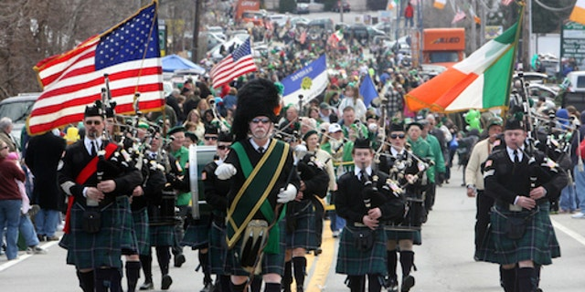 Members of theYorktown Irish Pipes and Drums Corps march in the 35th annual Northern Westchester-Putnam St. Patrick Day Parade March 13, 2011. Thousands of people lined route 6 in Mahopac to watch the parade, which is the third-largest St. Patrick's Day parade in New York state. ( Seth Harrison / The Journal News )