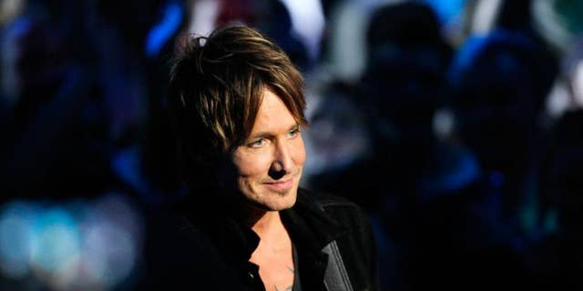 There's a reason (or three) why fans can't get enough of country star Keith Urban.
