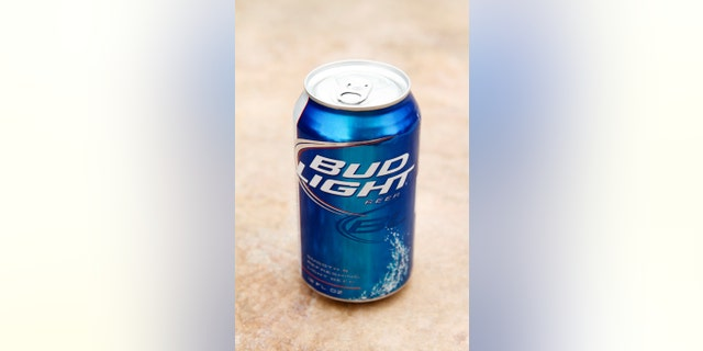 Indio, USA - June 1, 2011: A product shot of a can of Bud Light beer on a stone background. Bud Light is manufactured by Anheuser Busch,