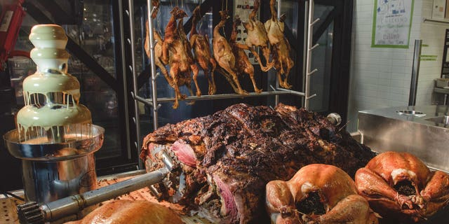 The massive roast is served at Bourboon Steak and Pub Tailgate party during San Francisco 49ers game versus the Seattle Seahawks on Thanksgiving Day.