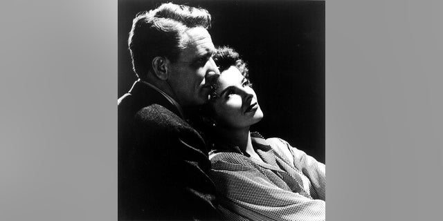 """Actress Katharine Hepburn is shown with actor Spencer Tracy in a 1945 photo from the film """"Without Love."""""""