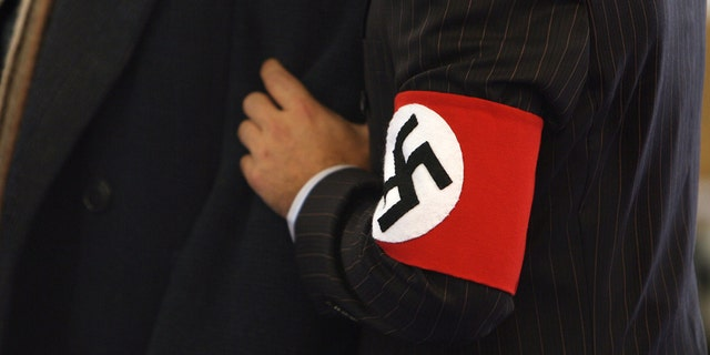A theater in Germany will have some patrons wearing a swastika armband while others wear the Jewish Star of David for a satirical production about Adolf Hitler's youth.