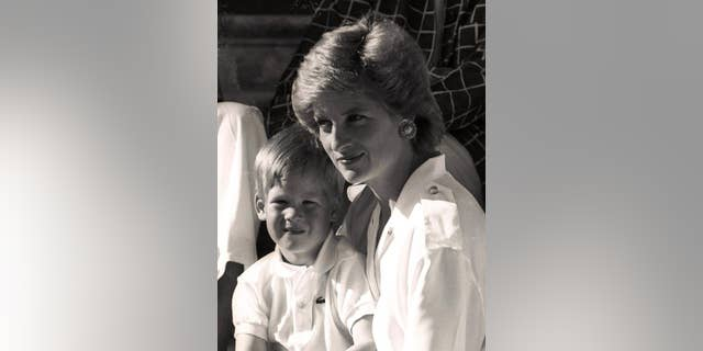 Princess Diana holds her son Prince Harry on her lap at Marivent Palace, the summer residence of the King and Queen of Spain.