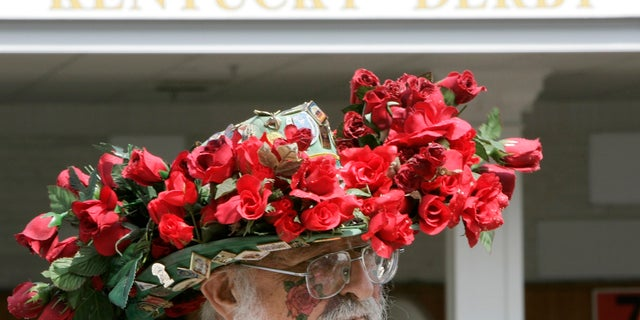A race fan displays his hat before the 134th running of the Kentucky Derby horse race at Churchill Downs.