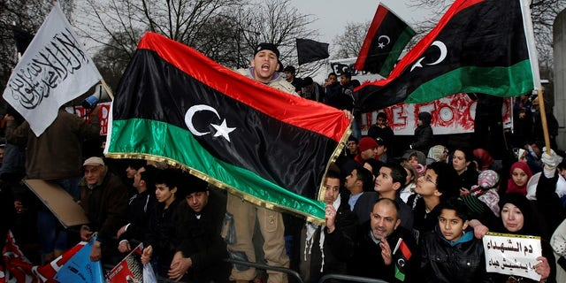 Demonstrators protest against Libya's Muammar Gaddafi outside the Libyan Embassy in London in 2011.