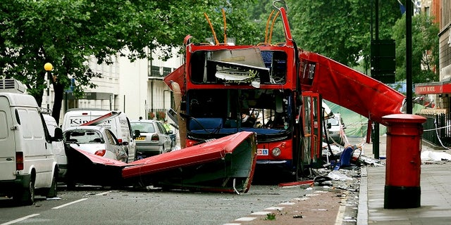 Debris is seen around the destroyed double decker bus after it was struck by a bomb in London in 2005.