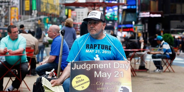 A volunteer from the religious group Family Radio hands out pamphlets warning of the impending Judgment Day. Harold Camping, an evangelist, predicted the end times would begin May 21, 2011.