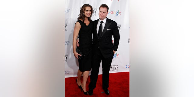 Actress Brooke Shields arrives with Chris Henchy at the 15th annual Webby Awards in New York June 13, 2011.