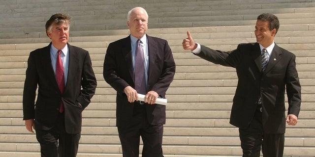 Sen. John McCain, along with Rep. Marty Meehan, D-Mass.; and Sen. Russ Feingold, D-Wis.; walk across the Supreme Court Plaza after attorneys made oral arguments during a special session of the Supreme Court on the constitutionality of the McCain-Feingold campaign finance reform law.