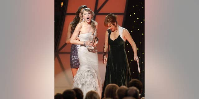 "Reba McEntire gave away many awards over the years that she hosted and co-hosted the ACM Awards. In 2010, she awarded Taylor Swift with ""Entertainer of the Year."""