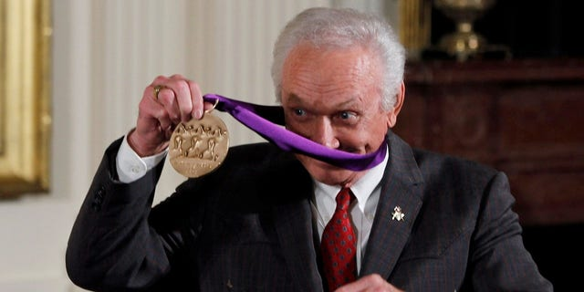 Mel Tillis is pictured with his National Medal of Arts after being presented with the award by U.S. President Barack Obama during a ceremony in the East Room of the White House in Washington.
