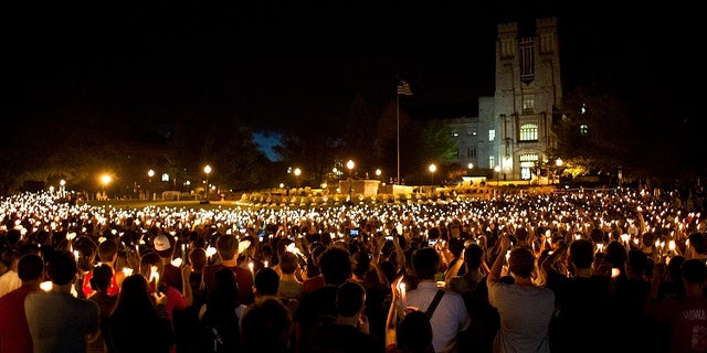 Members of the Blacksburg, Va., community hold a candlelight vigil five years after a mentally ill student went on a killing rampage around Virginia Tech's campus in 2007.
