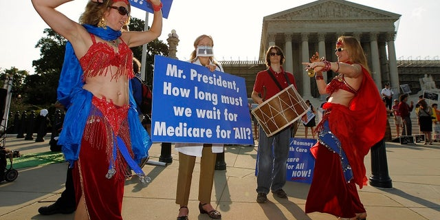 Belly dancers outside of the Supreme Court in 2012 call for a single-payer national health insurance program as the nation's highest court was set to rule on the Obama administration's health care overhaul.