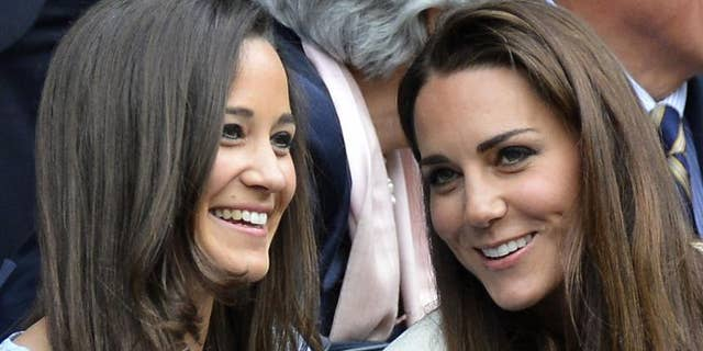 Pippa (L) with her older sister Catherine Middleton (R).