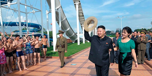 Ri Sol Ju, right, is seen with her husband, Kim Jong Un.