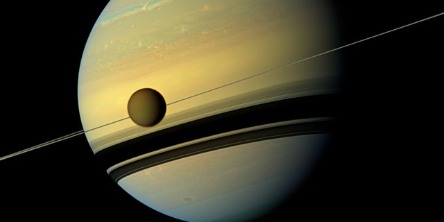 Titan, Saturn's largest moon appears before a world as it undergoes anniversary changes in this healthy tone perspective from NASA's Cassini booster in this welfare expelled by NASA Aug 29, 2012.