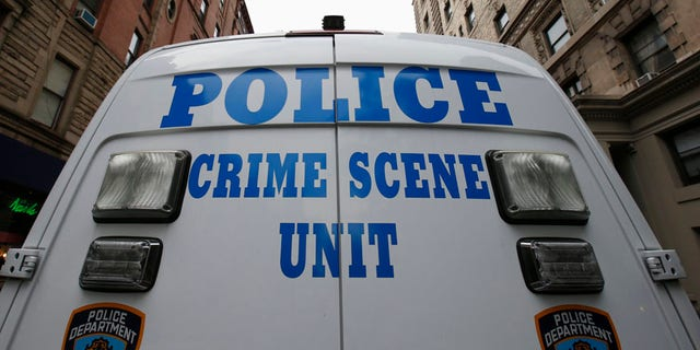 A New York City Police Crime Scene Unit vehicle stands on West 75th street
